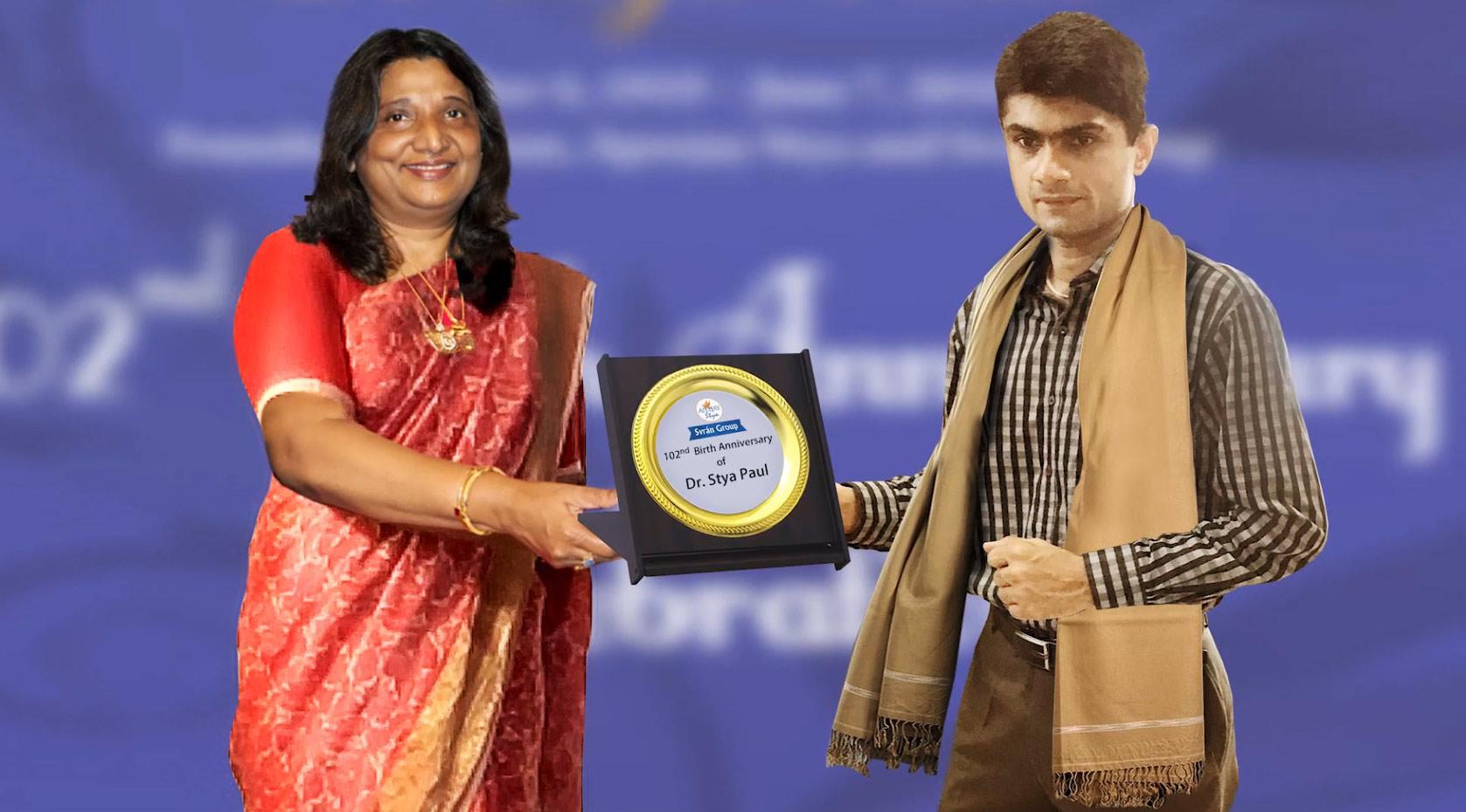 Mrs Berlia Felicitating Mr Suhas Yathiraj